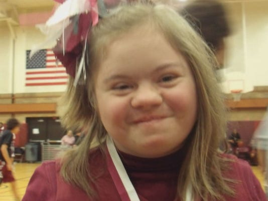 Middle School Athletes Defend Bullied Cheerleader With Down Syndrome